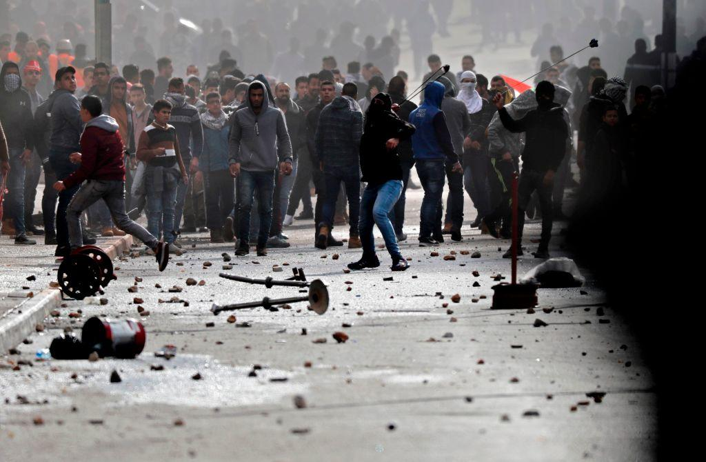 Palestinians Burn U.S. and Israeli Flags in Riots Over Jerusalem