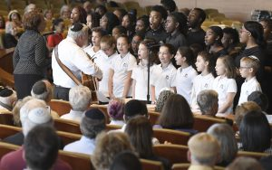 Children perform at Beth Tfiloh Congregation's Sept. 4 interfaith town hall meeting on Baltimore City.