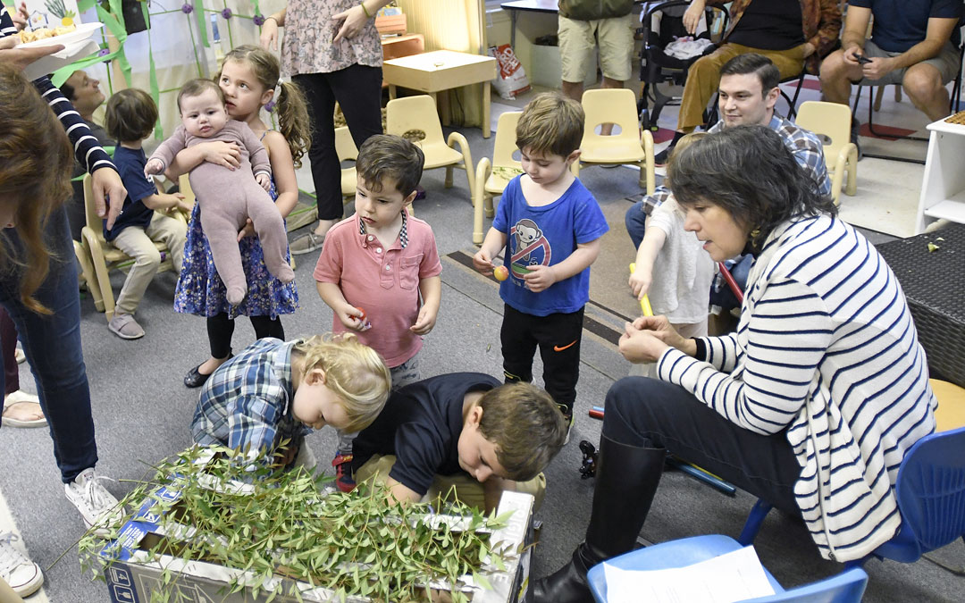 "Children create a small sukkah during the ""Sukkot Under the Stars"" event at Beth El preschool in Federal Hill. (Photo by Steve Ruark)"