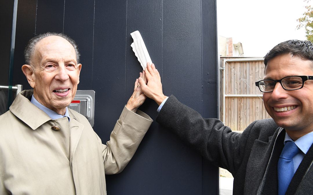Beth Am congregant and benefactor Mark Joseph (left) and Rabbi Daniel Cotzin Burg participate in the mezuzah-affixing ceremony. (Photo by Jim Burger)ededication ceremony concluded with the affixing of a mezuzah at the grand entrance of the nearly century-old building. (Photo by Jim Burger)