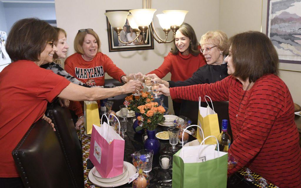 From left, Aileen Sweren, Rona Pepper, Iris Pressman, Diane Steinberg, Cheryl Rosenfeld and Carol Milner toast to their 20 years of meeting as a book club. (Photo by Steve Ruark)