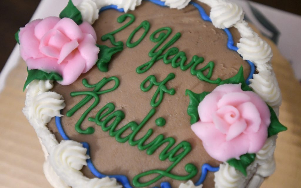 A cake marks 20 years of six local ladies meeting as a book club. (Photo by Steve Ruark)