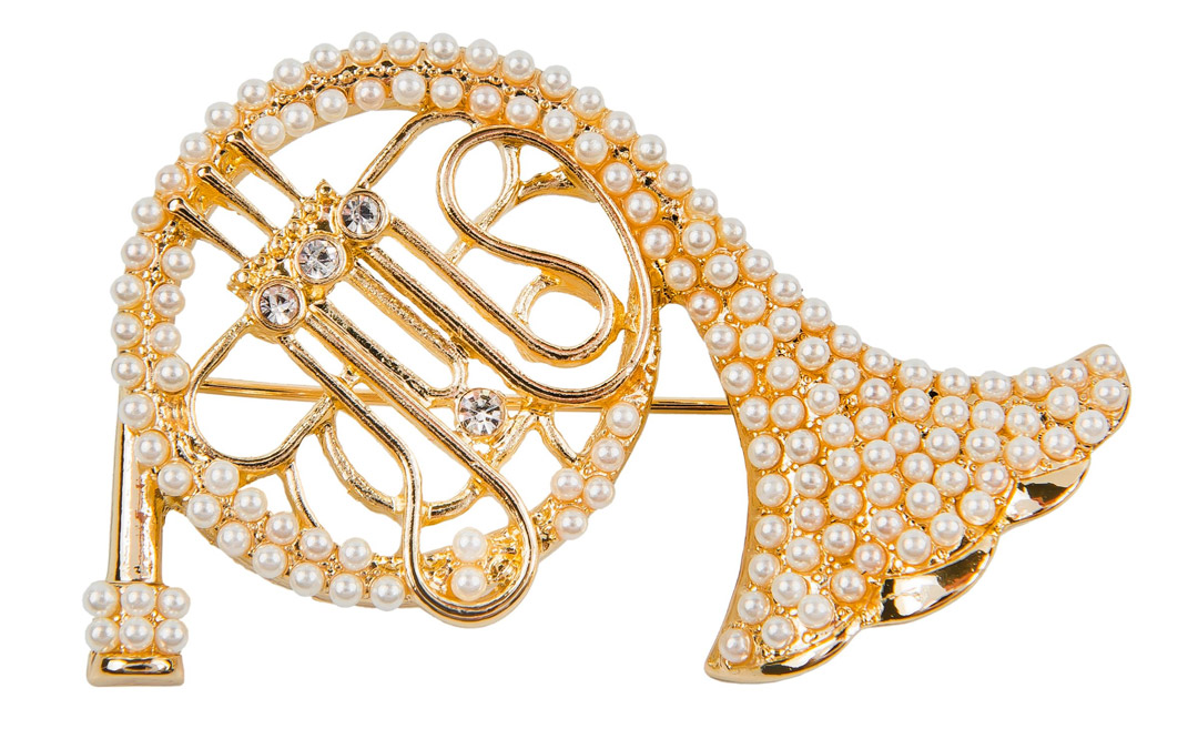 A pearl and horn pin will take your outfit from ordinary to extraordinary. $49.50 at Chico's