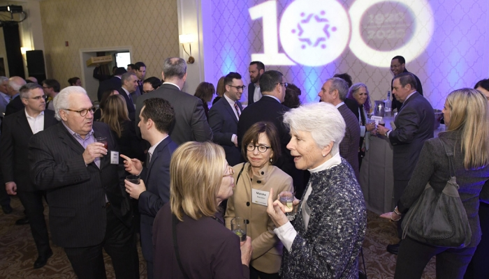 Guests, including Steven Manekin, front left, Brad Hecht, second from left, Marsha Manekin, center, and Vivian Manekin, front right, mingle during The Associated's Centennial Campaign kickoff. (Photo by Steve Ruark)