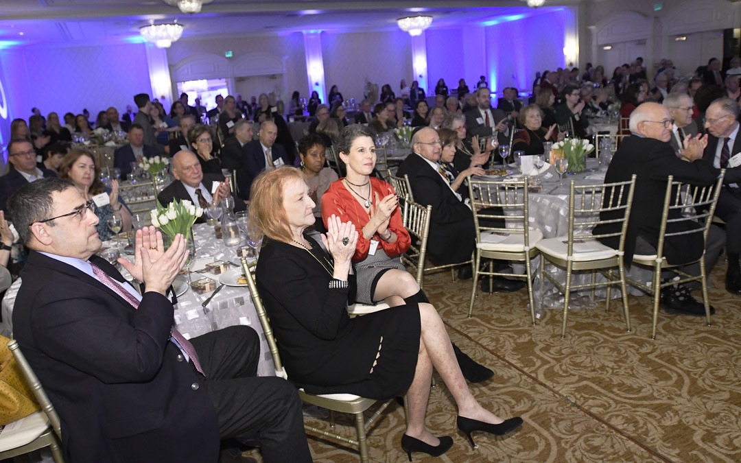 Guests applaud during The Associated's Centennial Campaign kickoff. (Photo by Steve Ruark)