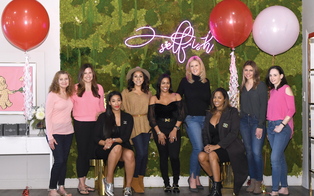 "From left, Simone Ellin, Aliza Friedlander, Self.ish Beauty co-owner Keisha McClain, Ariel Lewis, Self.ish Beauty co-owner Janeen Simon, Kirsten Johnsen, Self.ish Beauty co-owner Kelley Dailey, Jenn George and Tracy Friedlander gather at the start of a ""Galentine's Day"" outing at Self.ish Beauty in Pikesville. (Photo by Steve Ruark)"