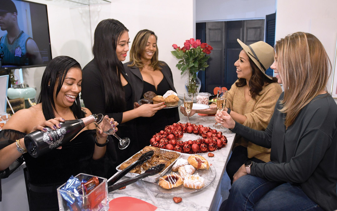 "From left, Self.ish Beauty co-owners Janeen Simon, Keisha McClain and Kelley Dailey chat with Ariel Lewis and Jenn George during a ""Galentine's Day"" outing at Self.ish Beauty in Pikesville. (Photo by Steve Ruark)"