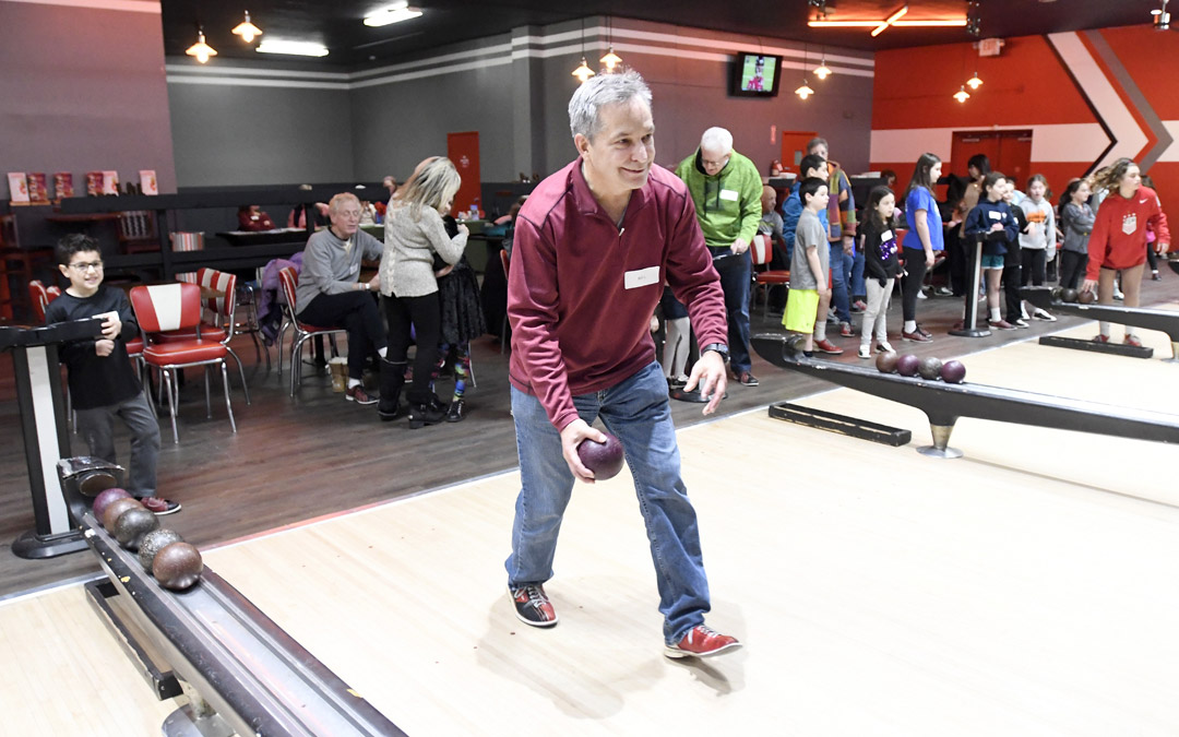 Bill London, of Owings Mills, bowls as his grandson Logan Harris, left, 7, of Pikesville watches during the Macks Center for Jewish Education's Saba-ba: Grandparents on the Go launch party at AMF Pikesville Lanes. The Saba-ba program brings together children and their grandparents. (Photo by Steve Ruark)
