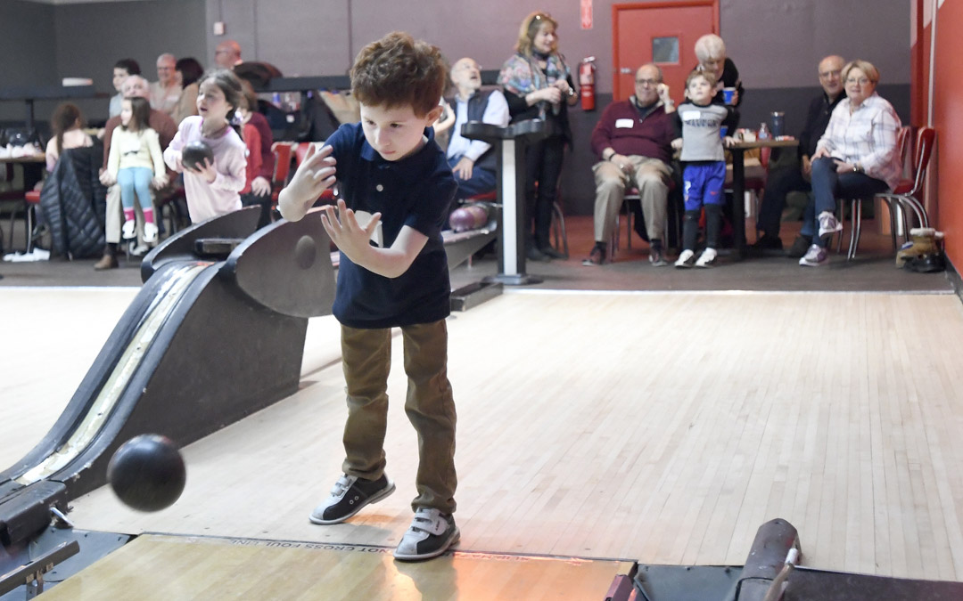 David Lowy, 6, of Pikesville, bowls during the Macks Center for Jewish Education's Saba-ba: Grandparents on the Go launch party at AMF Pikesville Lanes. The Saba-ba program brings together children and their grandparents. (Photo by Steve Ruark)