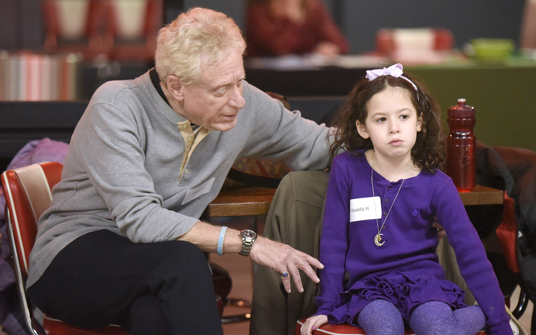 Stuart Tabb, of Reisterstown and his granddaughter Maddy Heston, 6, of Timonium, chat during the Macks Center for Jewish Education's Saba-ba: Grandparents on the Go launch party at AMF Pikesville Lanes. The Saba-ba program brings together children and their grandparents. (Photo by Steve Ruark)