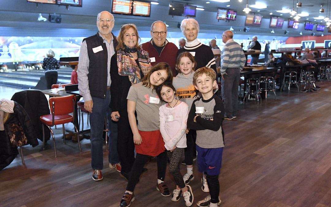 Back row, from left, Gil Abramson, Ann Abramson, Robert Mankin and Vivian Mankin stand with their grandchildren during the Macks Center for Jewish Education's Saba-ba: Grandparents on the Go launch party at AMF Pikesville Lanes. (Photo by Steve Ruark)