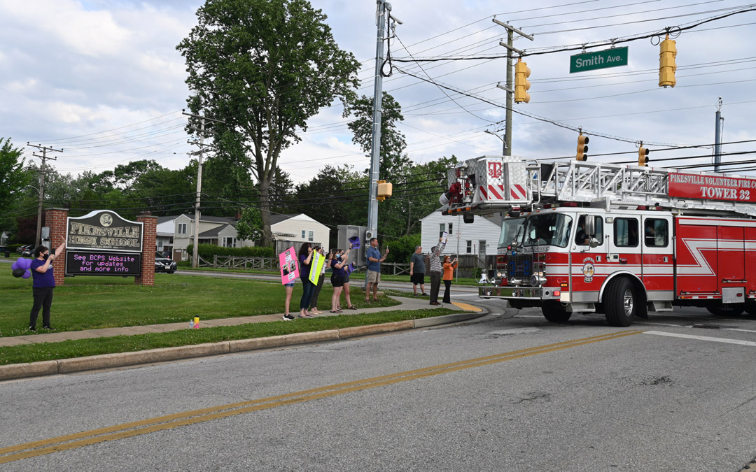 A Pikesville Volunteer Fire Company firetruck leads the mini-procession and turns onto Labyrinth Road. (Photo by Michael Schwartzberg/PVFC)
