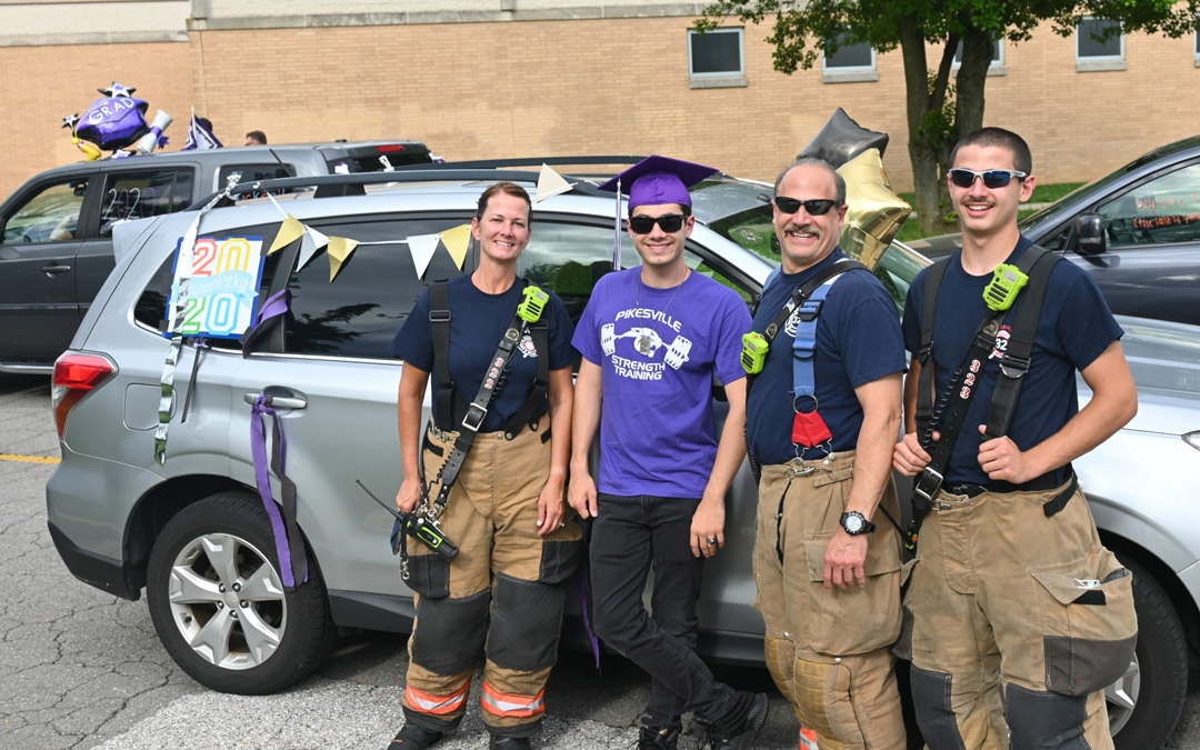 Heroes in our Midst: Members of the Pikesville Volunteer Fire Company turn out to cheer for the graduating seniors. (Photo by Michael Schwartzberg/PVFC)