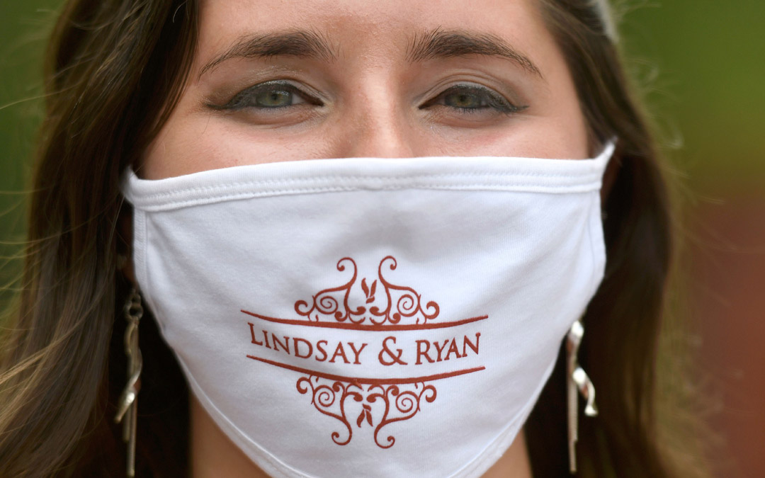 Among the wedding party favors were face masks bearing the names of the bride and groom.