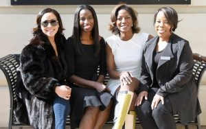(From left to right): Ariel Lewis, left, sits with Art of Balance Wellness Spa co-owners Dr. Aderonke Omotade and Dr. Nia Banks, and esthetician Alicia Allen.