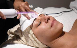 Ariel Lewis receives a facial treatment.