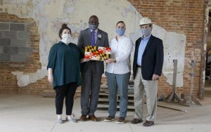 Katherine Good, of Waldon Studio Architects; Dr. Gary Rodwell of Coppin Heights Community Development Corp.; Meagan Baco of Preservation Maryland; and Donald Kann of Waldon Studio Architects