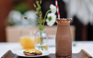 """Magdalena: A Maryland Bistro's """"Charm City Cookie"""" cocktail with a side of gold-dusted Berger cookies."""
