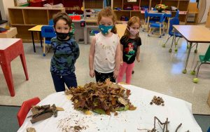 Pre-K class sharing the spoils of their nature adventure.
