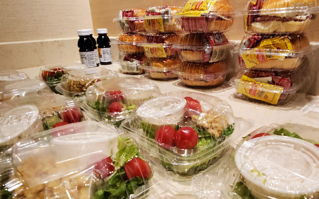Refreshments at the ceremony included kosher pre-packaged kiddush meals. (Photo by Naftali Druk, Chabad of Downtown)