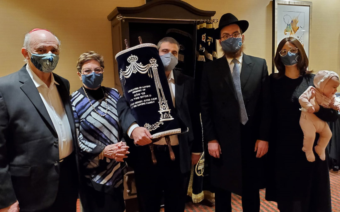 Chabad of Downtown celebrates the arrival of the Harold Jeter Torah. (Left to right) Avron Lewin, Jacqui Juter, Elton Juter, Rabbi Levi Druk and Chani Druk. (Photo by Naftali Druk, Chabad of Downtown)